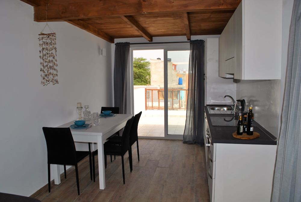 Kitchen And Entrance Door Sea View Studio Apartment Casa Tud Dret Bobby Was Here